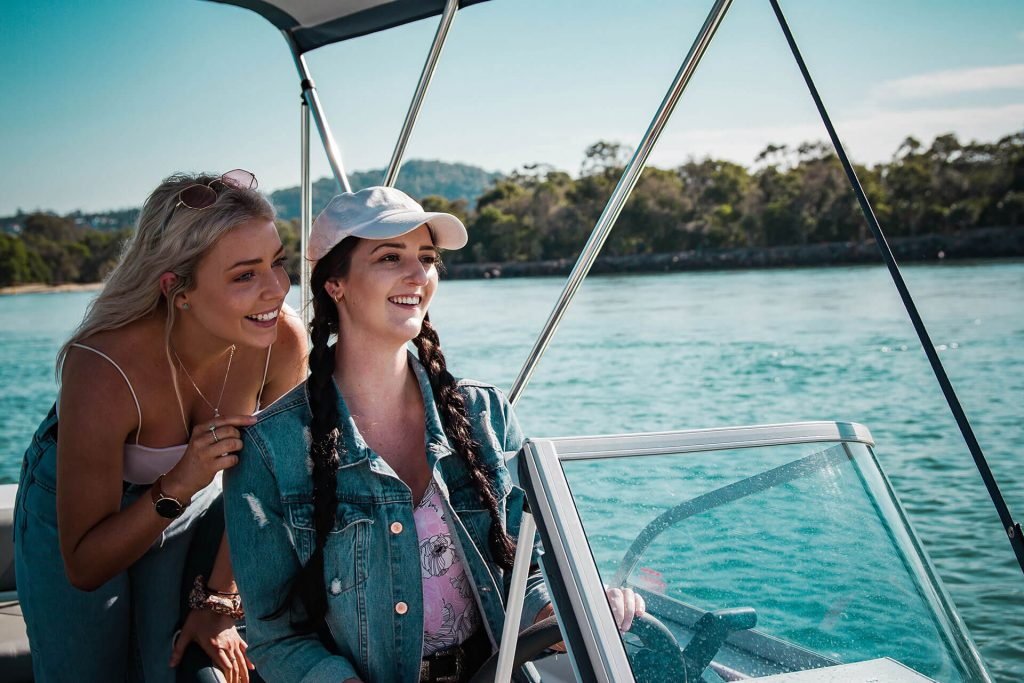 Girls boating on the Noosa River